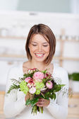 Happy girl with flowers — Stock Photo