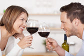 Happy couple toasting with red wine — Stock Photo