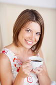 Portrait of a woman with coffee — Stock Photo