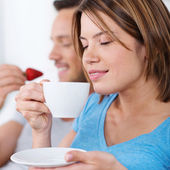 Pretty woman enjoying a cup of coffee — Stock Photo