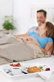 Couple with breakfast — Stock Photo