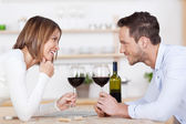 Happy couple and red wine — Stock Photo