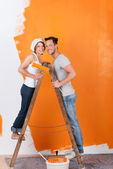 Young couple on a ladder — Stock Photo