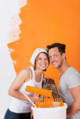 Happy couple painting their flat — Stock Photo
