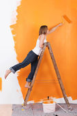 Woman on a ladder — Stock Photo