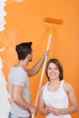 Young man painting — Stock Photo