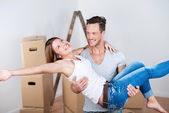 Joyful couple moving into their new home — Stock Photo