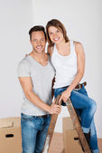 Happy couple packing up their household goods — Stock Photo