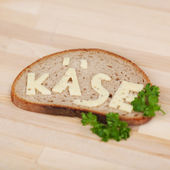 Slice of bread with the Cheese word written on it — Stock Photo
