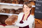 Happy friendly bakery worker — Stock Photo