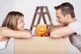Couple with piggybank — Stock Photo