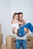 Loving man carrying his wife — Stock Photo