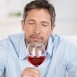 Mature Man Testing Wine At Home — Stock Photo