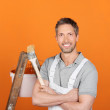 Confident Painter Against Orange Painted Wall — Stock Photo