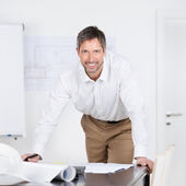 Mature Male Architect With Blueprints At Desk — Stock Photo