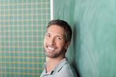 Happy Teacher Against Blackboard — Stock Photo
