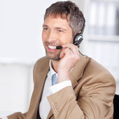 Happy Customer Service Executive Conversing On Headset — Stock Photo