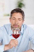 Mature Man Testing Wine At Home — Stock Photo