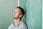 Thoughtful Handsome Teacher Against Blackboard — Stock Photo