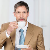 Businessman Enjoying Coffee In Office — Stock Photo