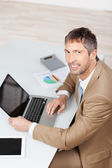 Mature Businessman With Laptop And Digital Tablet At Desk — Stock Photo