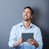 Happy Businessman With Digital Tablet Against Blue Wall — Stock Photo