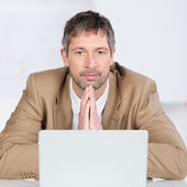 Serious Businessman With Laptop In Office — Stock Photo