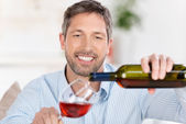 Man Pouring Wine In Wineglass At Home — Stock Photo