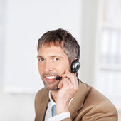 Smiling Customer Service Executive Conversing On Headset — Stock Photo