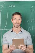 Smiling Male Teacher Holding Digital Tablet — Stock Photo
