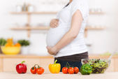 Vegetables With Pregnant Woman In Background — Stock Photo