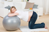 Smiling Pregnant Woman Exercising With Pilates — Stock Photo