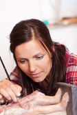 Woman Using Brush On Statue In Workshop — Stock Photo