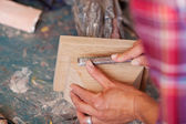 Woman Carving Wood In Workshop — Stock Photo