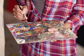 Woman Mixing Paint On Palette — Stock Photo