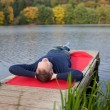 Man Lying On Pier Against Lake — Stock Photo