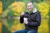 Man Dipping Tea Bag In Cup Outdoor — Stock Photo
