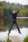 Excited Mature Man Jumping On Pier — Stock Photo