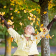Autumn Leaves Falling On Senior Woman — Stock Photo