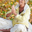 Stock Photo: WomWith Hands Clasped Meditating In Park