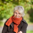 Senior Woman Shivering In Park — Stock Photo