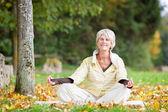 Senior Woman Meditating In Lotus Position — Stock Photo