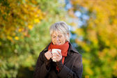 Senior Woman Enjoying Coffee In Park — Stock Photo