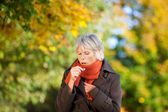 Senior Woman Suffering From Cough In Park — Stock Photo