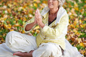 Woman With Hands Clasped Meditating In Park — Stock Photo