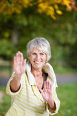 Senior Woman Performing Tai Chi In Park — Stock Photo