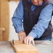 Carpenter Wearing Ear Protectors While Using Table Saw — Stock Photo