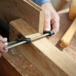 Carpenter's Hands Using Screw Clamp On Wood — Stock Photo #26931449