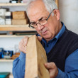 Experienced carpenter checking the edges — Stock Photo