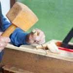 Senior Man Using Chisel And Hammer On Wood — Stock Photo
